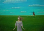 「A windmill can be seen in the meadow」